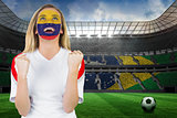 Excited colombia fan in face paint cheering