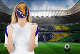 Excited bosnia fan in face paint cheering