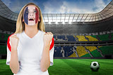 Excited france fan in face paint cheering
