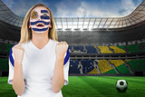 Excited fan in uruguay face paint cheering