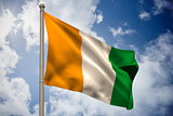 Ivory coast national flag on flagpole