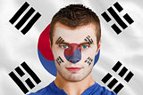 Serious young football fan in face paint