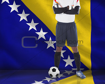 Goalkeeper in white looking at camera