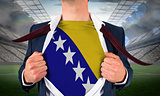 Businessman opening shirt to reveal bosnia flag