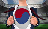 Businessman opening shirt to reveal korea republic flag