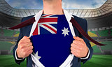 Businessman opening shirt to reveal australia flag