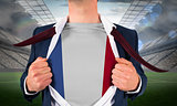 Businessman opening shirt to reveal france flag