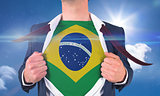 Businessman opening shirt to reveal brasil flag