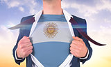 Businessman opening shirt to reveal argentina flag