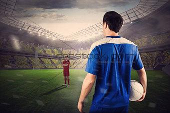 Football players facing off