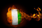 Fire surrounding ivory coast ball