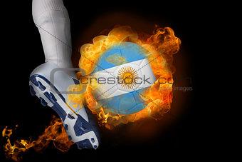 Football player kicking flaming argentina flag ball