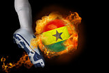 Football player kicking flaming ghana flag ball