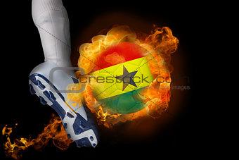 Football player kicking flaming ghana flag ball