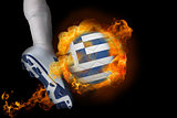 Football player kicking flaming greece flag ball
