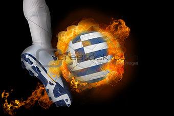 Football player kicking flaming greece flag ball