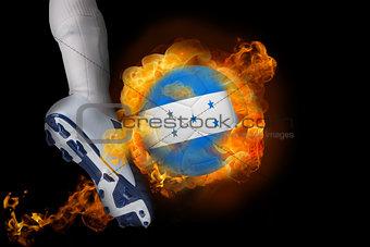 Football player kicking flaming honduras flag ball