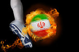 Football player kicking flaming iran ball