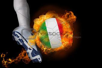 Football player kicking flaming italy ball
