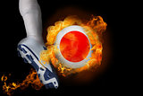 Football player kicking flaming japan ball