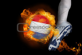 Football player kicking flaming netherlands ball