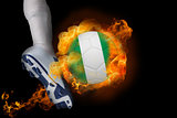 Football player kicking flaming nigeria ball