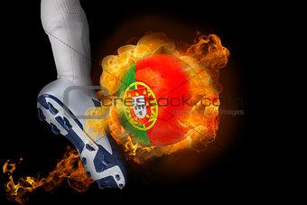 Football player kicking flaming portugal ball