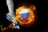 Football player kicking flaming russia ball