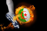 Football player kicking flaming algeria ball