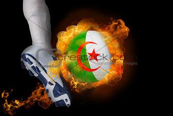 Football player kicking flaming algeria ball