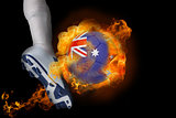 Football player kicking flaming australia ball