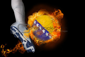 Football player kicking flaming bosnia ball