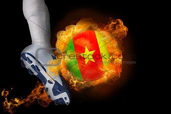 Football player kicking flaming cameroon ball
