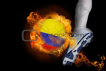 Football player kicking flaming colombia ball