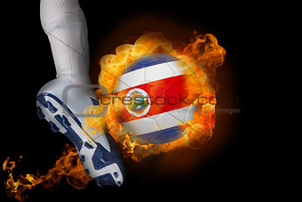 Football player kicking flaming costa rica ball