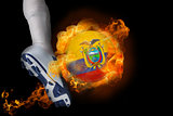 Football player kicking flaming ecuador ball