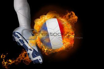 Football player kicking flaming france ball