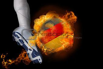 Football player kicking flaming germany ball