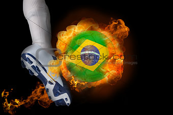 Football player kicking flaming brasil ball