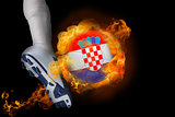 Football player kicking flaming croatia ball