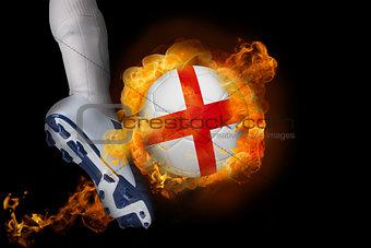 Football player kicking flaming england ball