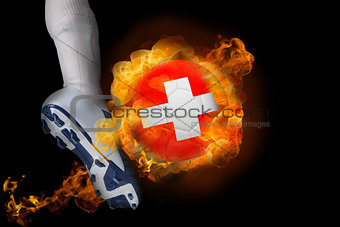 Football player kicking flaming switzerland ball
