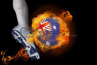 Football player kicking flaming australia ball