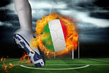 Football player kicking flaming italy flag ball