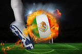 Football player kicking flaming mexico flag ball