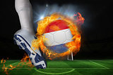 Football player kicking flaming netherlands flag ball