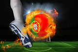 Football player kicking flaming portugal flag ball