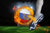 Football player kicking flaming russia flag ball