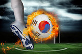 Football player kicking flaming south korea flag ball