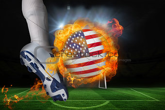 Football player kicking flaming usa flag ball